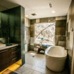 master bathroom with large picture window and stand alone tub