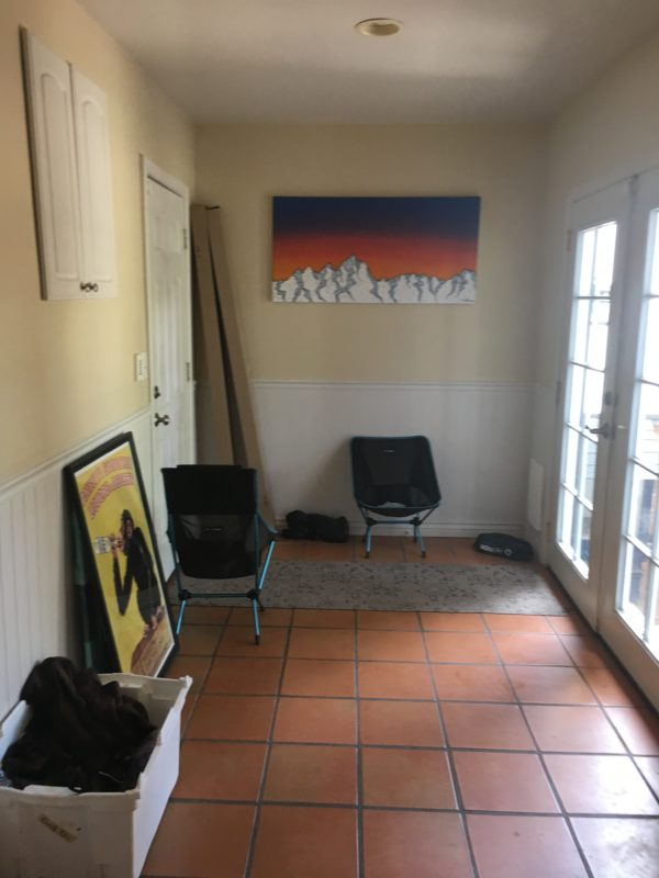 before picture of entry way. french doors to the right and closet on the left, tile flooring