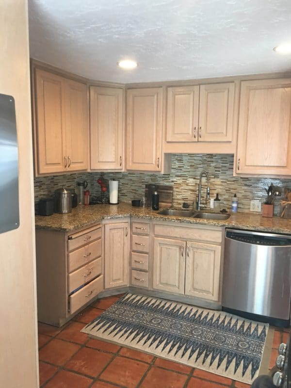 before kitchen with maple cabinets stainless appliances and tile floor