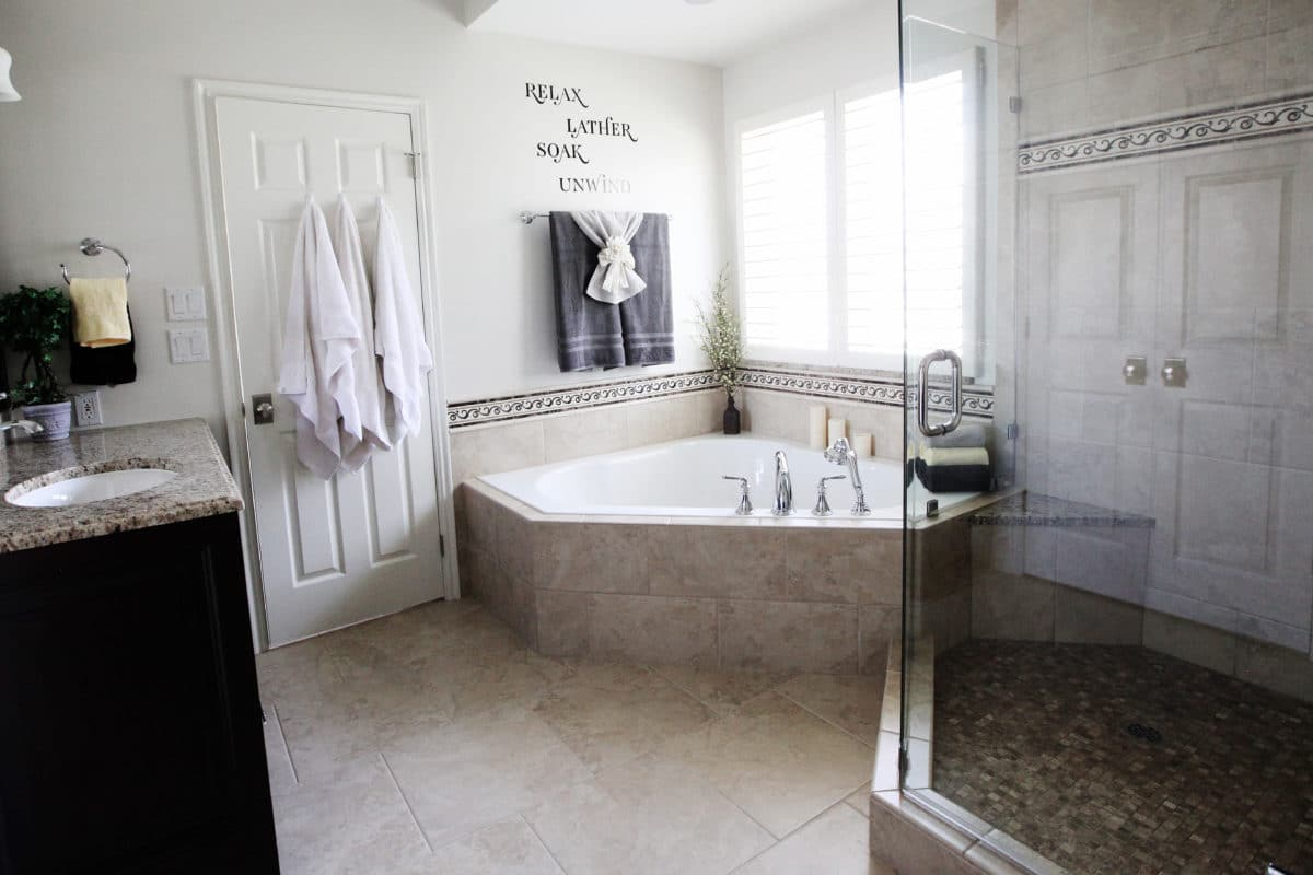 corner tub and glass enclosed shower