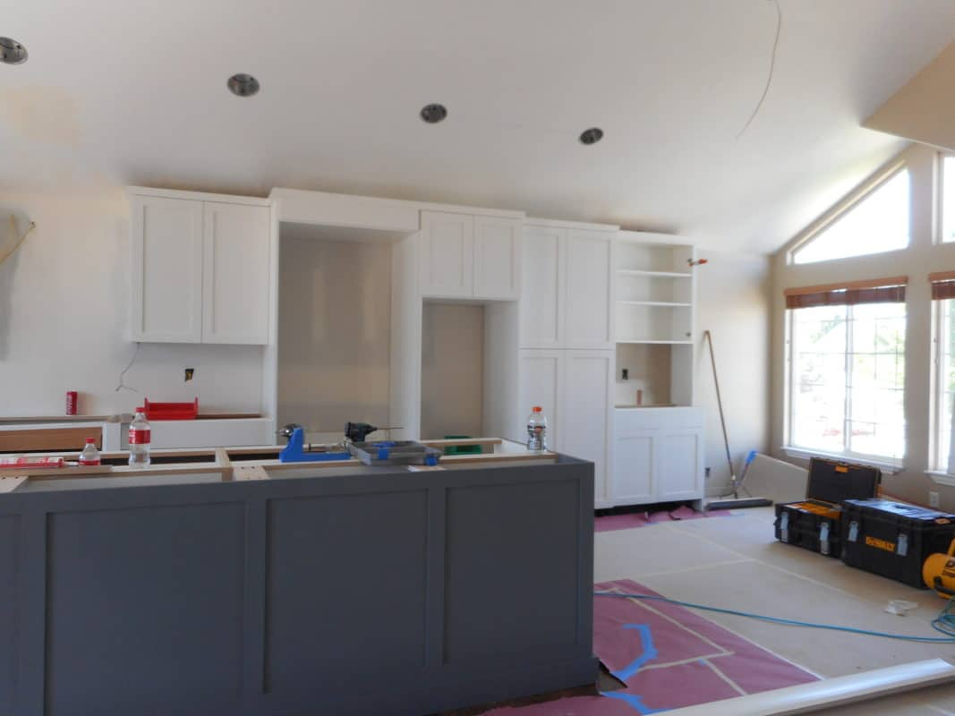 cabinets being installed during a kitchen remodel