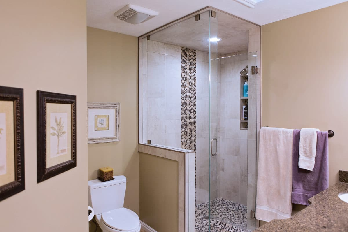 master bathroom with glass enclosed shower